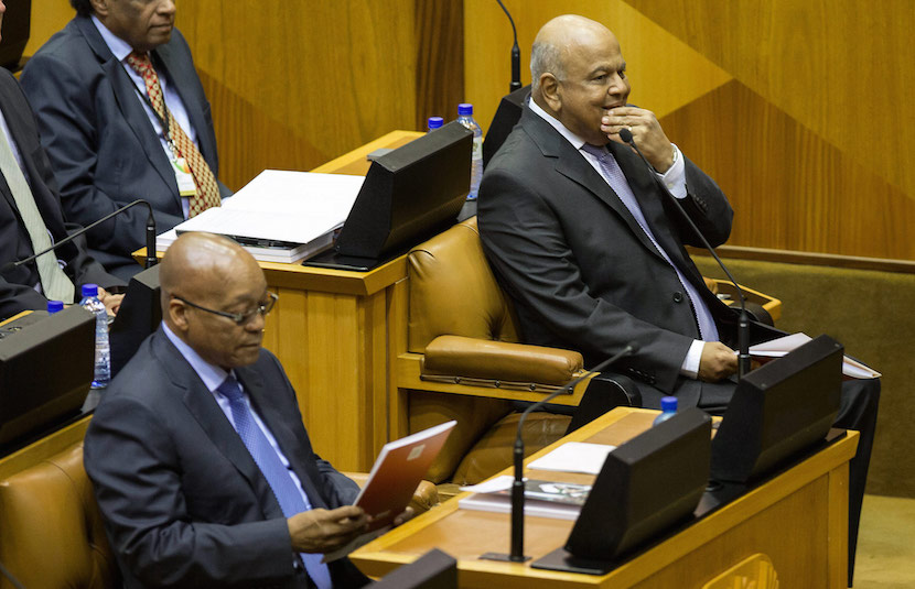 Pravin Gordhan, South Africa's finance minister, right, sits beside Jacob Zuma, South Africa's president, left, before delivering his 2016 budget speech to parliament in Cape Town, South Africa, on Wednesday, Feb. 24, 2016. Gordhan stuck to a pledge to bring down the budget deficit, targeting civil-servant jobs and increasing wealth taxes to stave off a credit-rating downgrade to junk. Photographer: Halden Krog/Bloomberg