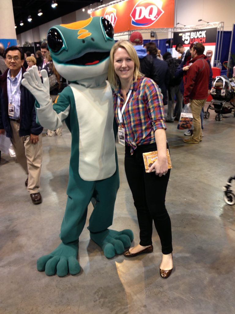 Having your pic taken with the Geico Gekko is popular at the Berkshire AGM - not with insurance analyst Cliff Galen, though.