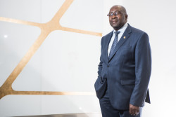 Nhlanhla Nene, South Africa's former finance minister, poses for a photograph following an interview in Johannesburg, South Africa, on Monday, May 18, 2015. South Africa is committed to selling stakes in Eskom Holdings SOC Ltd. as long as the government maintains control of the power utility, Nene said. Photographer: Waldo Swiegers/Bloomberg *** Local Caption ** Nhlanhla Nene