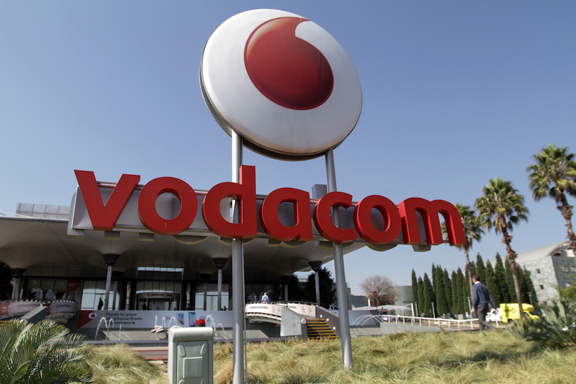 A logo sits on display outside the headquarters of Vodacom Group Ltd. in Johannesburg, South Africa, on Monday, May 18, 2015. Vodacom, the wireless carrier with the most subscribers in South Africa, said full-year earnings declined as increasing competition weighed on calling prices. Photographer: Dean Hutton/Bloomberg