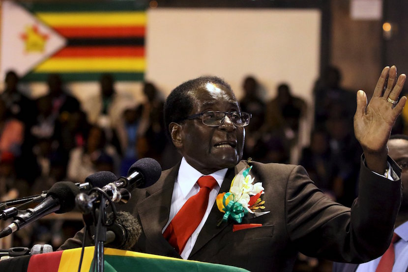 Zimbabwe's President Robert Mugabe gestures while addressing a meeting of veterans of the country's independence war in the capital Harare, April 7, 2016. REUTERS/Philimon Bulawayo