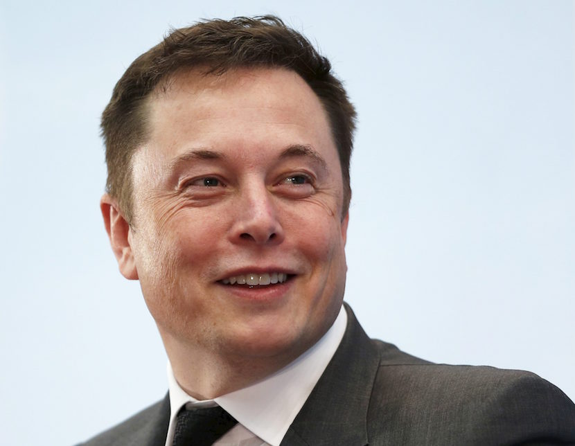 Tesla Chief Executive Elon Musk smiles as he attends a forum on startups in Hong Kong, China January 26, 2016. REUTERS/Bobby Yip/File Photo