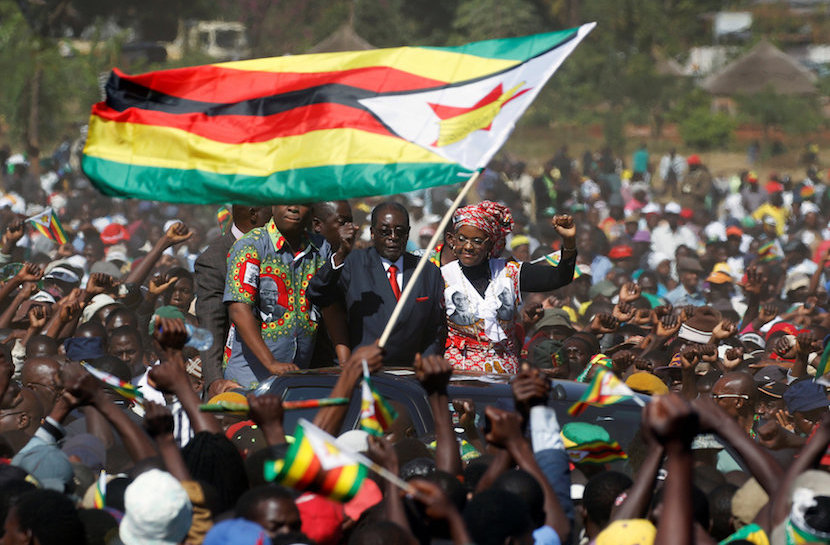 "Zimbabwe's President Robert Mugabe and his wife Grace greet supporters of his ZANU (PF) party during the ""One Million Man March"", a show of support of Mugabe's rule in Harare, Zimbabwe, May 25, 2016. REUTERS/Philimon Bulawayo."