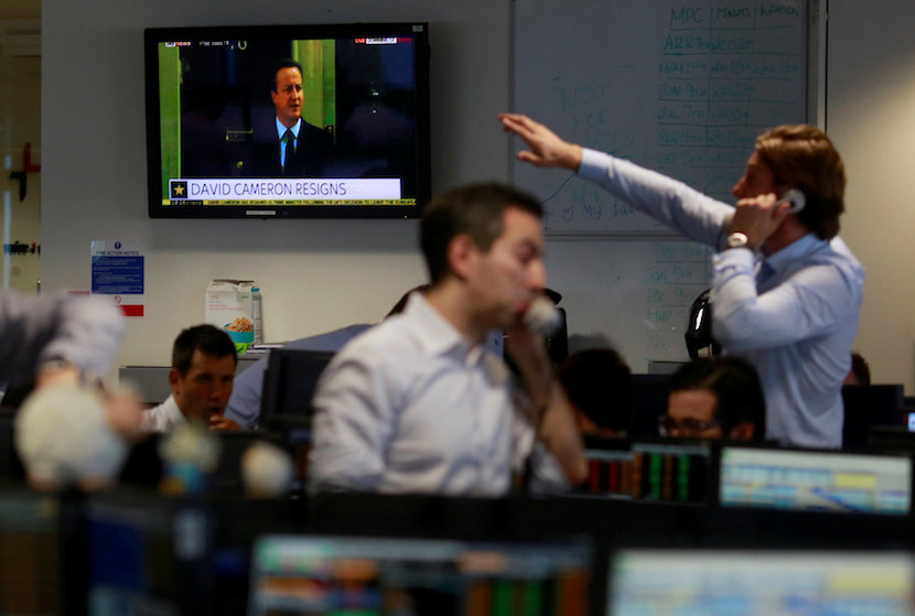 A TV shows the resignation of Britain's Prime Minister David Cameron as traders from BGC, a global brokerage company in London's Canary Wharf financial centre react after European stock markets opened June 24, 2016 after Britain voted to leave the European Union in the EU BREXIT referendum. REUTERS/Russell Boyce