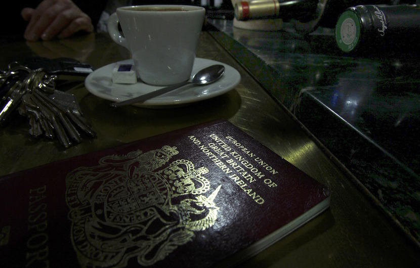 """File photo illustration shows a European Union British Passport on the counter of a cafe in Paris, France, January 23, 2013. Carmakers and soccer chiefs threw their weight behind the campaign for Britain to stay in the European Union June 20, 2016, as opinion polls showing the """"Remain"""" camp gaining ground buoyed shares and sterling three days ahead of the referendum. REUTERS/Mal Langsdon/File Photo"""
