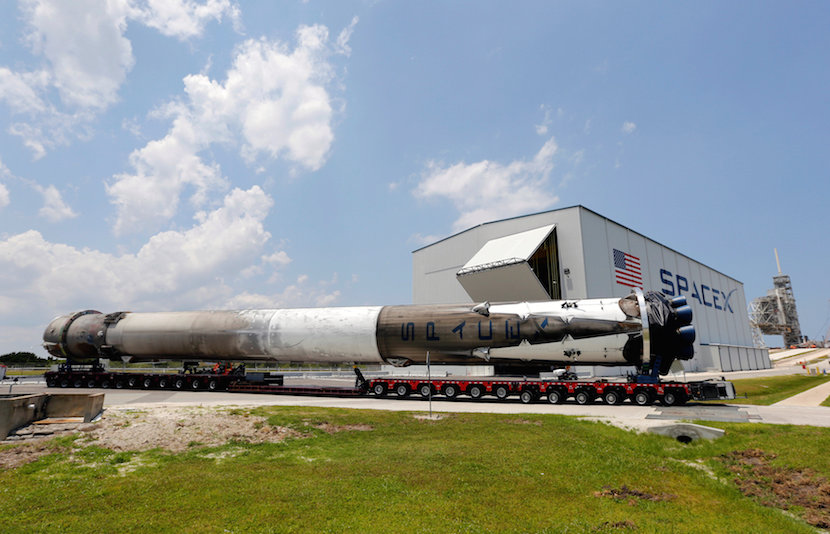 The recovered first stage of a SpaceX Falcon 9 rocket is transported to the SpaceX hangar at launch pad 39A at the Kennedy Space Center in Cape Canaveral, Florida May 14, 2016. The vehicle was launched on May 6 and returned to land a short time later aboard a barge in the Atlantic Ocean. REUTERS/Joe Skipper