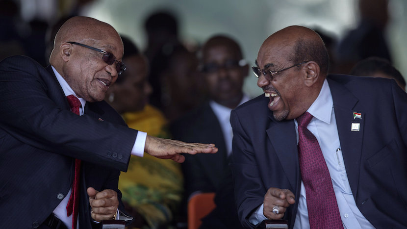 Sudan's President Omar Hassan al-Bashir (R) laughs while having a conversation with his South African countarpart Jacob Zuma at the swearing-in ceremony of Uganda's president, Yoweri Kaguta Museveni at the Kololo independence grounds in Kampala, Uganda, May 12, 2016. REUTERS/Edward Echwalu