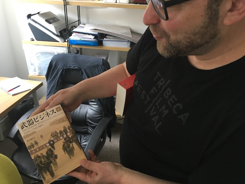 Andre Feinstein's book on the global arms industry has been translated into many languages - here he holds the Japanese edition.