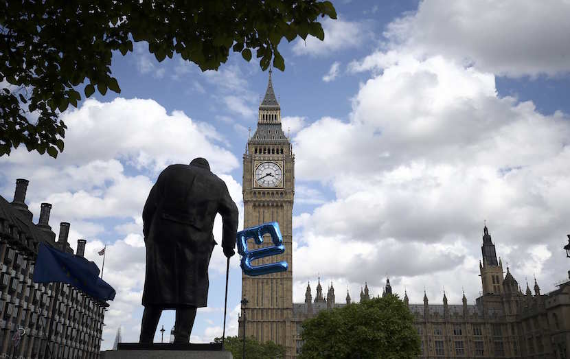 A balloon is tied to the Winston Churchill statue in Parliament Square during a 'March for Europe' demonstration against Britain's decision to leave the European Union, in central London, Britain. Britain voted to leave the European Union in the EU Brexit referendum. REUTERS/Neil Hall