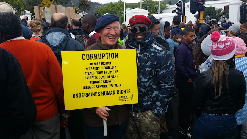 Arms deal activist Terry Crawford-Browne marching outside Parliament with a member of the Economic Freedom Fighters.