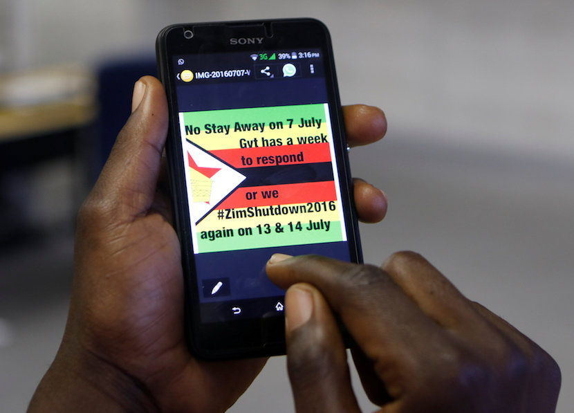 A man checks a message on his mobile phone, in Harare, Zimbabwe, July 7, 2016. REUTERS/Philimon Bulawayo