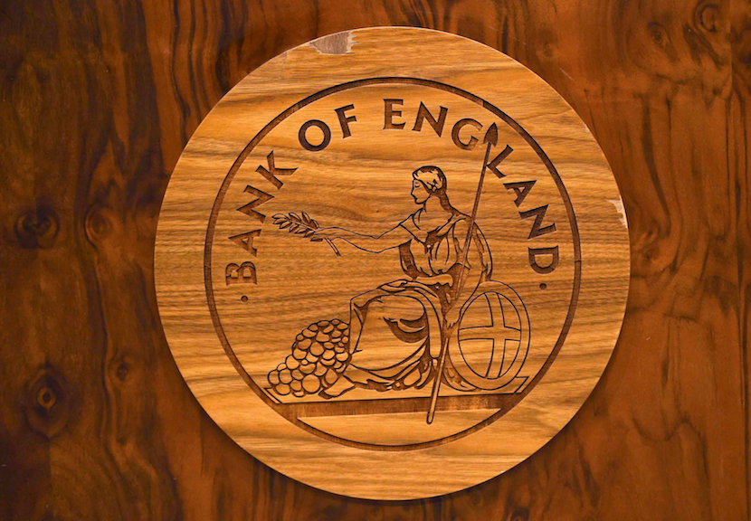 A wooden carving of the Bank of England logo is seen on a desk during a news conference at the Bank of England in London, Britain. REUTERS/Dylan Martinez/File Photo