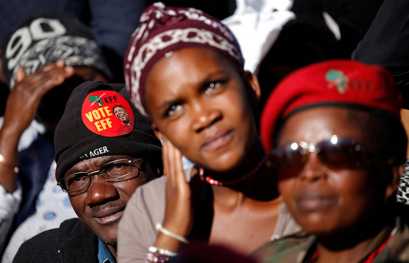 Supporters of South Africa's Economic Freedom Fighters (EFF) listen to their leader Julius Malema. REUTERS/Siphiwe Sibeko.