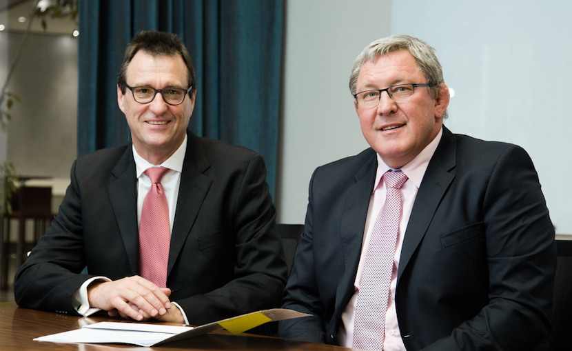 Stuart Clarkson, CEO of ADT South Africa (L) with Wahl Bartmann, CEO of Fidelity Group (R).
