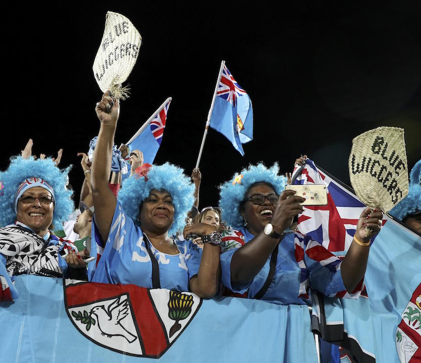 2016 Rio Olympics - Rugby - Men's Victory Ceremony - Deodoro Stadium - Rio de Janeiro, Brazil - 11/08/2016. Fiji rugby fans cheer during ceremony. REUTERS/Phil Noble