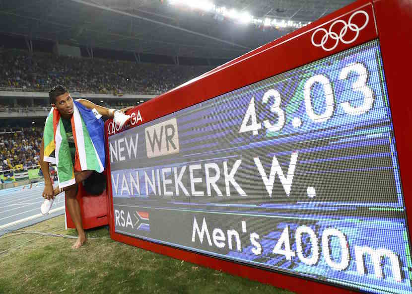 2016 Rio Olympics - Athletics - Final - Men's 400m Final - Olympic Stadium - Rio de Janeiro, Brazil - 14/08/2016. Wayde van Niekerk (RSA) of South Africa celebrates after winning the gold. REUTERS/Kai Pfaffenbach.