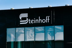 A Steinhoff International Holdings NV logo sits on display outside the company's offices in Stellenbosch, South Africa, on Wednesday, Aug. 17, 2016. Acquisitions including Pepkor Holdings Pty Ltd. and French furniture chain Conforama France SA have transformed Steinhoff International Holdings NV, which employs 90,000 people and has more than 6,500 stores in 30 countries from the U.K. to Australia. Photographer: Waldo Swiegers/Bloomberg