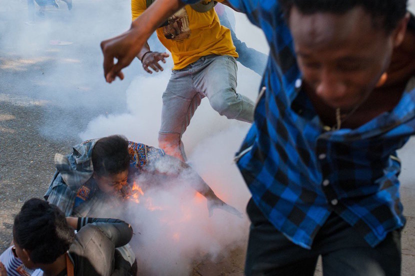 A Wits student is burned by a police flashbang grenade during protests. Pic by Daylin Paul #Fees2017 #FeesMustFall