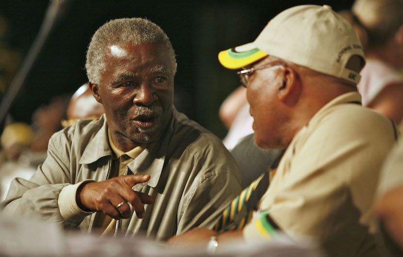 s president, left, applaud at the African National Congress conference in Polokwane, South Africa, on Monday, Dec. 17, 2007. Photographer: Greg Marinovich/Bloomberg News