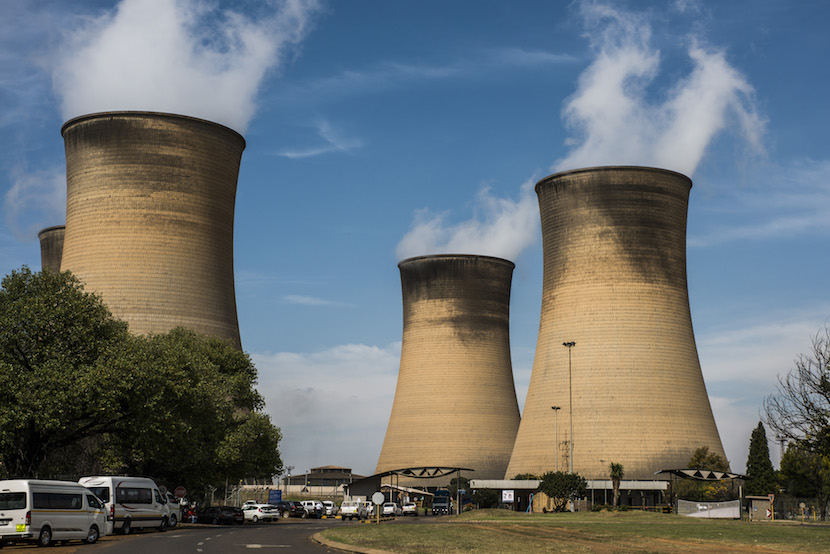 Cooling towers operate at the Hendrina power station, operated by Eskom Holdings SOC Ltd., in Middelburg, South Africa, on Wednesday, April 13, 2016. Creditors of Glencore's Optimum Coal mine approved a plan to sell it to a company controlled by South African President Jacob Zuma's son and the Gupta family on Friday, according to an administrator of the business-rescue team. Photographer: Waldo Swiegers/Bloomberg