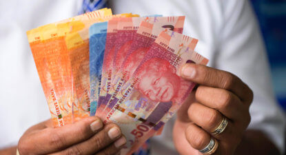 Rand holds steady as rupee and peso hit record lows