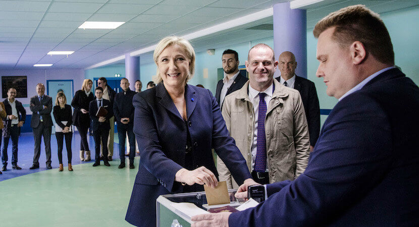 Le Pen tells French voters: 'France will be governed by a woman – choose me or Merkel'