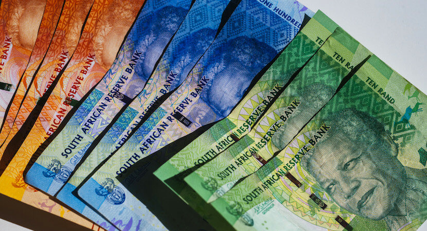 Rand breaches key level, strongest against dollar since August
