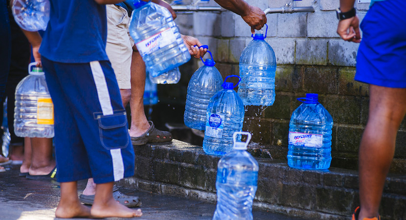 4f8c07b57a Residents queue to fill plastic water bottles at a natural water spring on  the site of SABMiller Plc's Newlands brewery in Cape Town, February 7, 2018.