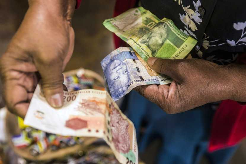 File Photo: A vendor counts out rand banknotes while working in an African craft market in the Rosebank district of Johannesburg. Photographer: Waldo Swiegers/Bloomberg pocket money